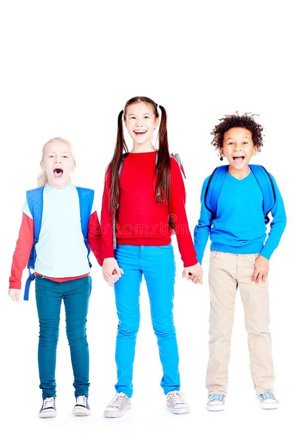 Happy three school friends stock photos