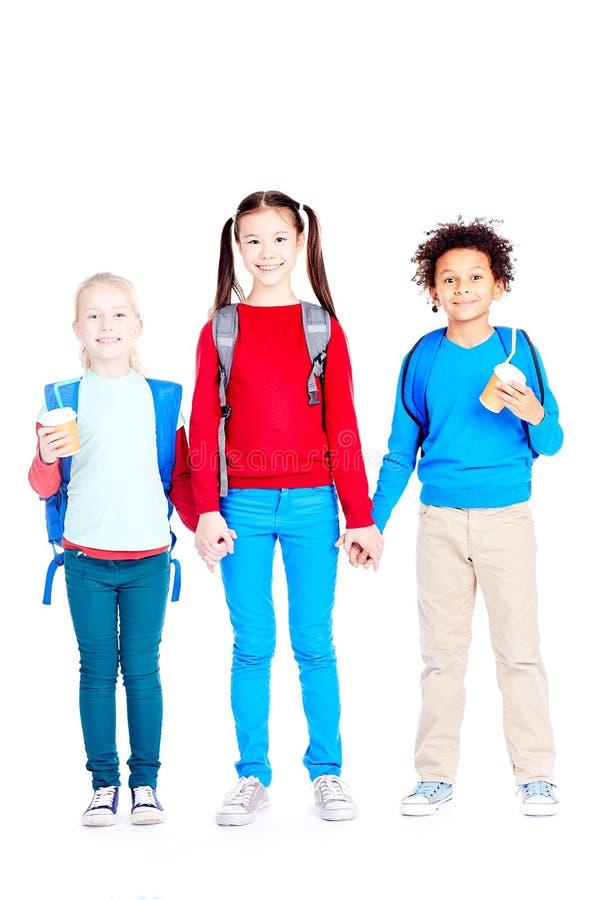 Happy three school friends stock image