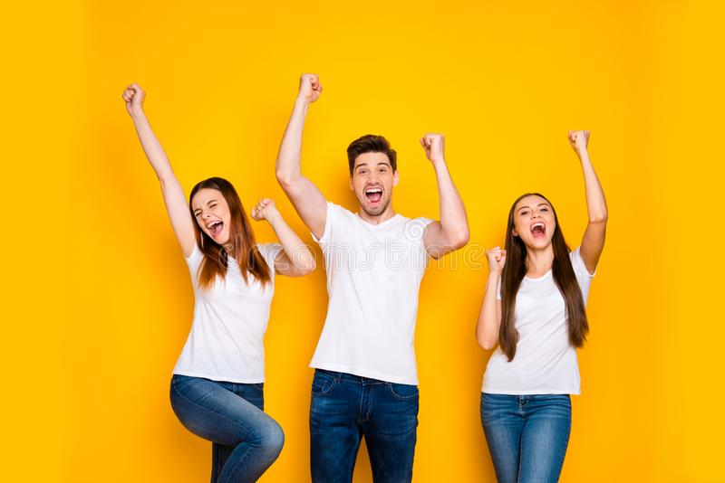 Portrait of three nice attractive lovely cheerful cheery person celebrating cool attainment having fun rising hands up. Portrait of three nice attractive lovely royalty free stock photos