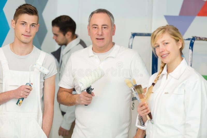 Portrait three painter decorators. Portrait of three painter decorators royalty free stock photography