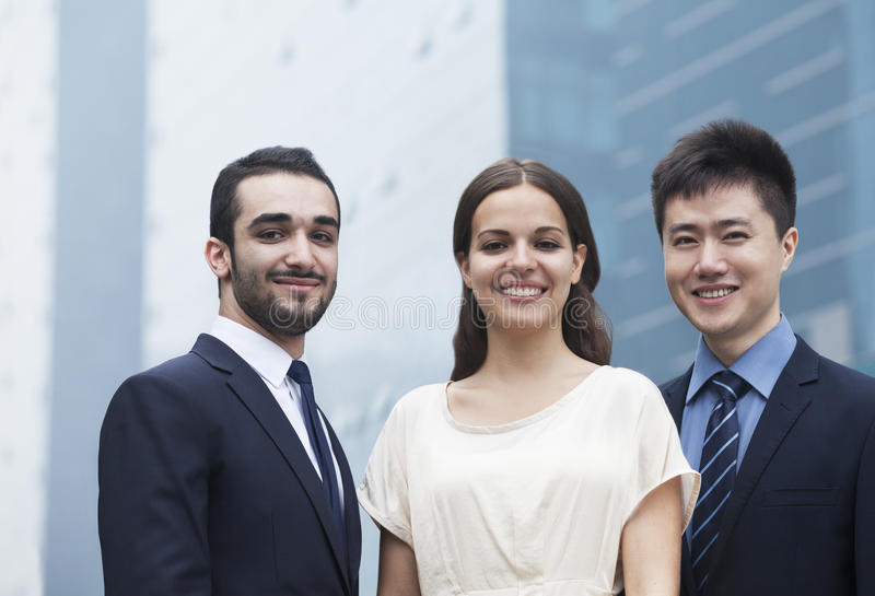 Download Portrait Of Three Smiling Business People, Outdoors, Business District Stock Photo - Image: 33403250