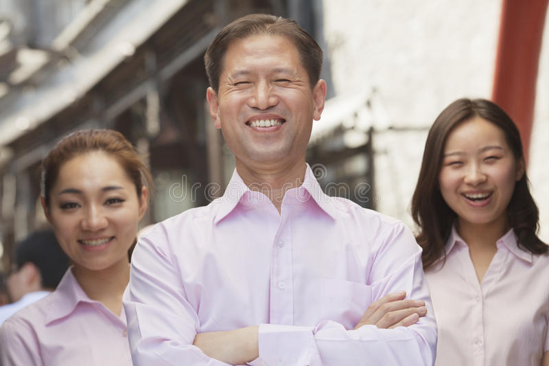 Download Portrait Of Three Smiling Well-dressed People Standing In A Row, Beijing Stock Image - Image of 20, button: 31126537