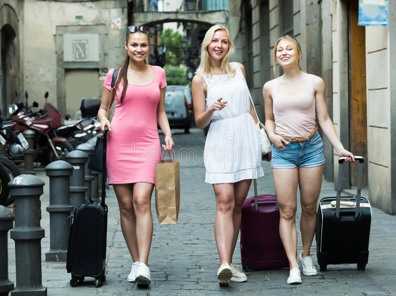 Portrait of three smiling young girls tourists royalty free stock photos