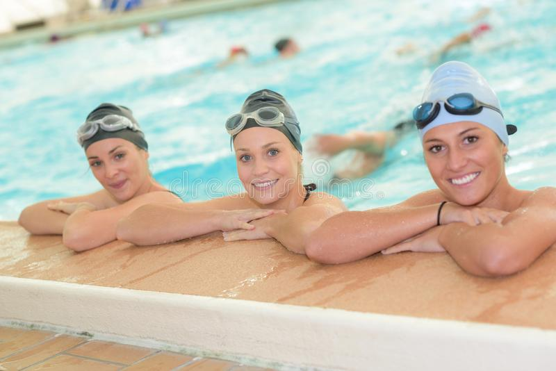 Portrait three swimmers posing royalty free stock photos