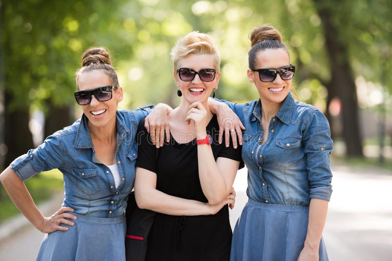 Portrait of three young beautiful woman with sunglasses stock image