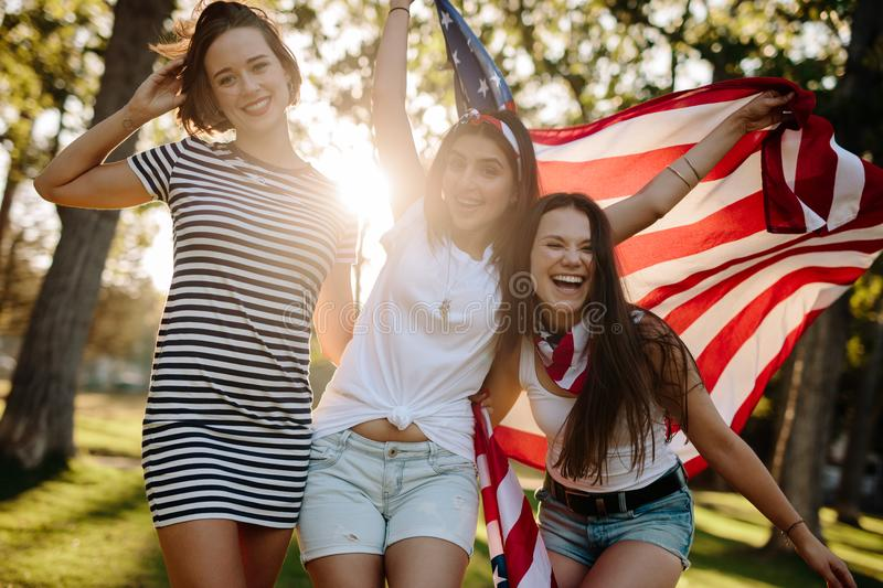 Female friends with American flag royalty free stock photos