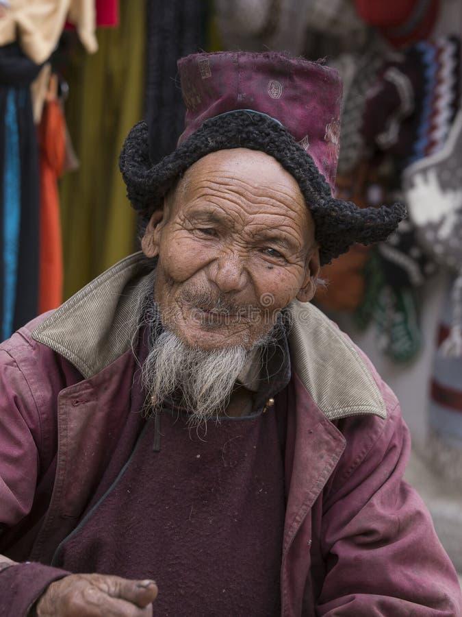 Portrait tibetan old man on the street in Leh, Ladakh. India royalty free stock images