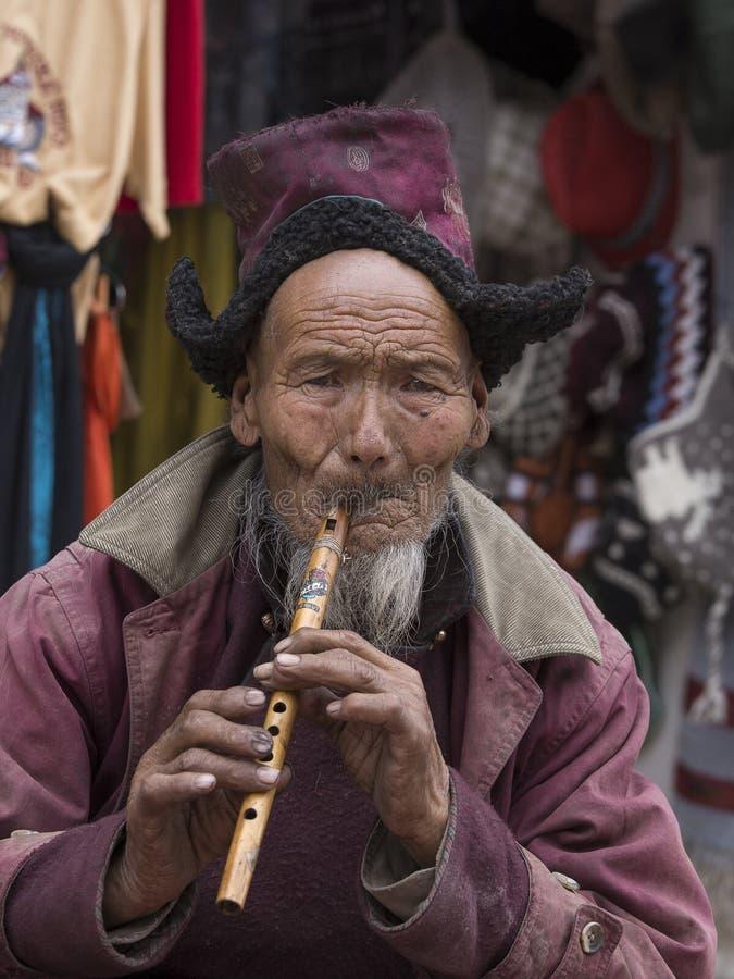 Portrait tibetan old man on the street in Leh, Ladakh. India stock photos