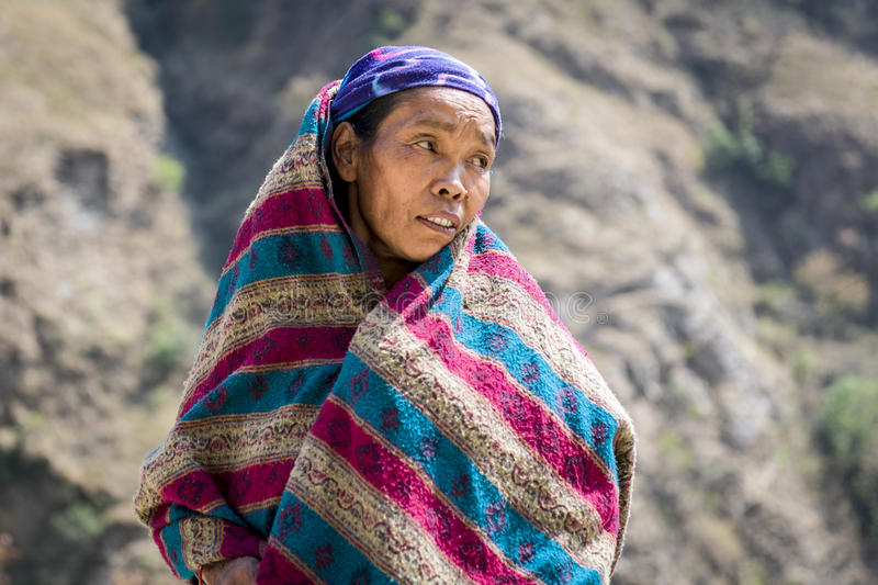Portrait of tibetan woman in Himalaya Mountains. KALOPANI, NEPAL - MARCH 18: Portrait of tibetan woman poses for the photo on the way to local market in Himalaya stock photos