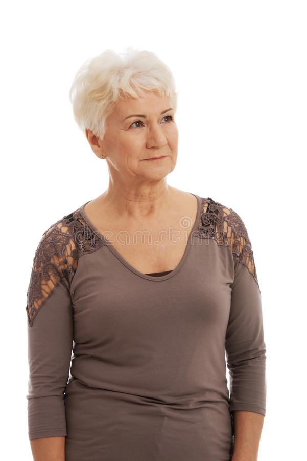 Portrait of a tidy, trim old lady. royalty free stock photo
