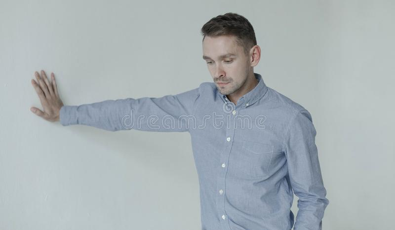 Portrait of tired business man looking down, turn head away from the camera royalty free stock photos