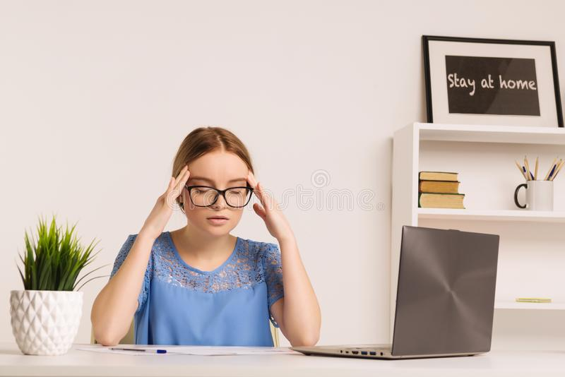 Portrait of tired businesswoman having headache at workplace after working with computer royalty free stock photo