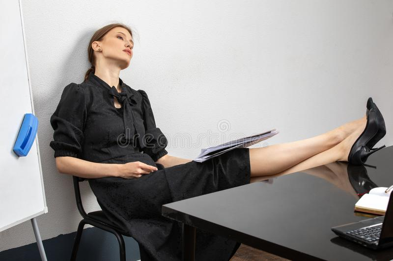 Portrait of a tired female teacher royalty free stock image