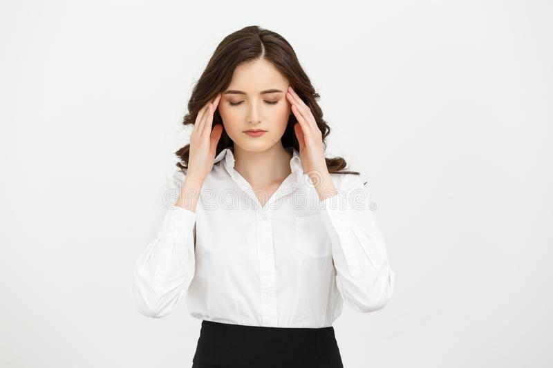 Portrait of tired woman touching her head isolated over white background. Portrait of tired woman touching her head isolated over white background stock images