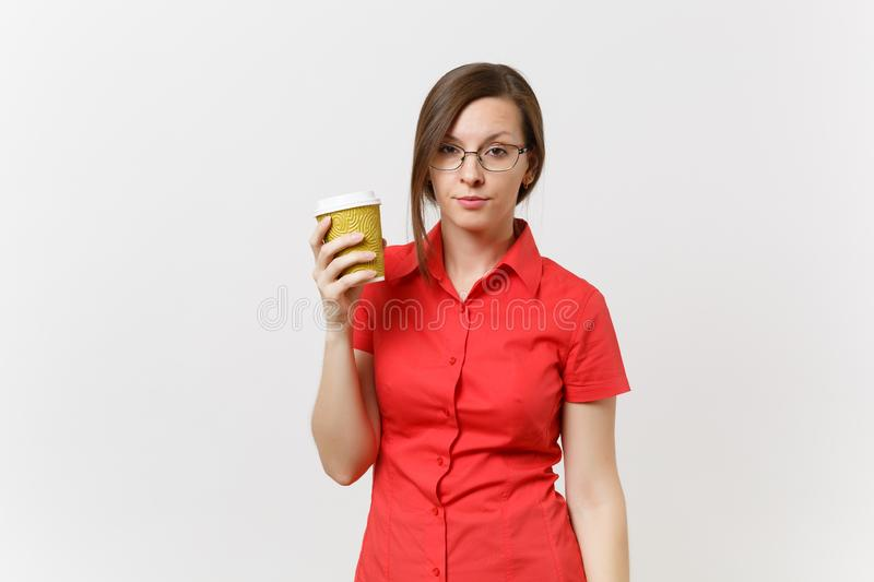 Portrait of tired young business teacher woman in red shirt glasses holding cup of coffee or tea in hands isolated on stock photos