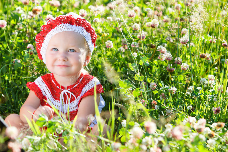Portrait of toddler girl in meadow stock photography