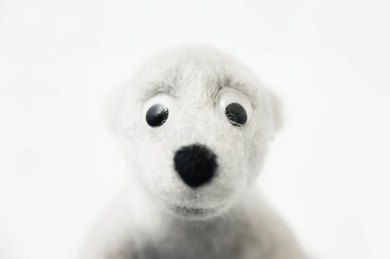 Portrait of toy polar bear made of felted wool on white background. A portrait of toy polar bear made of felted wool on white background stock images