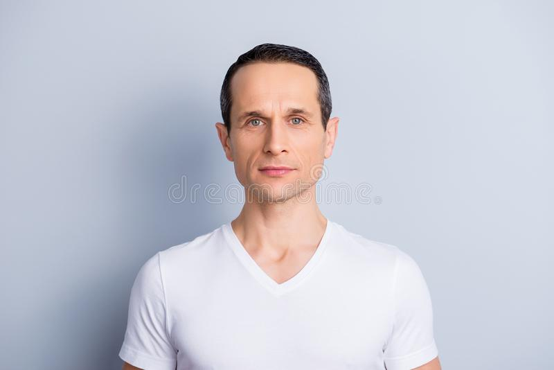 Portrait of trendy, neat, shaven, brunet man in white t-shirt wi stock photo