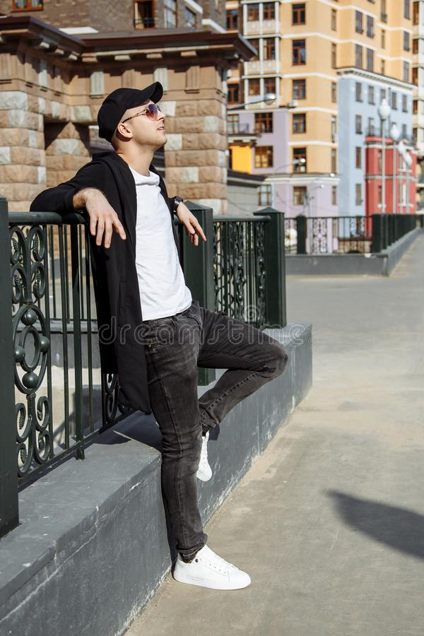 Portrait of a trendy young man in the city. stock photos
