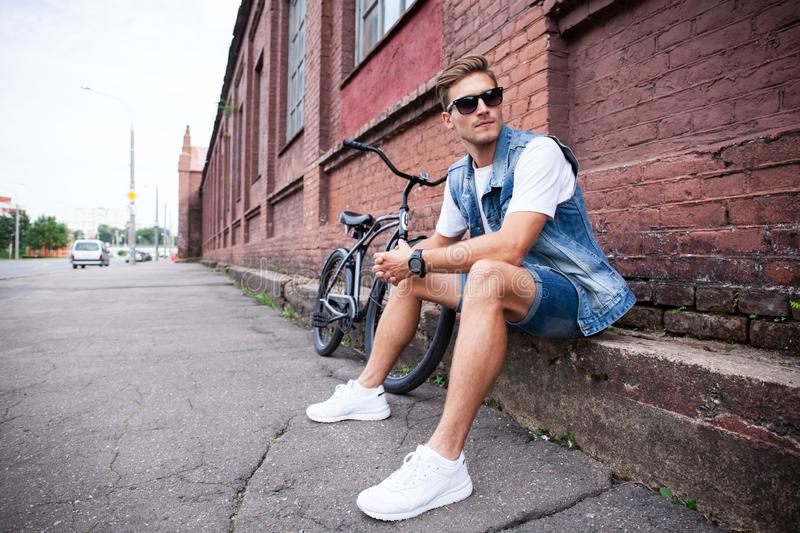 Portrait of a trendy young man in the city. royalty free stock photo