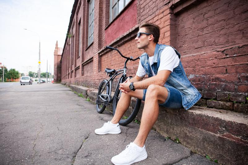 Portrait of a trendy young man in the city. royalty free stock image
