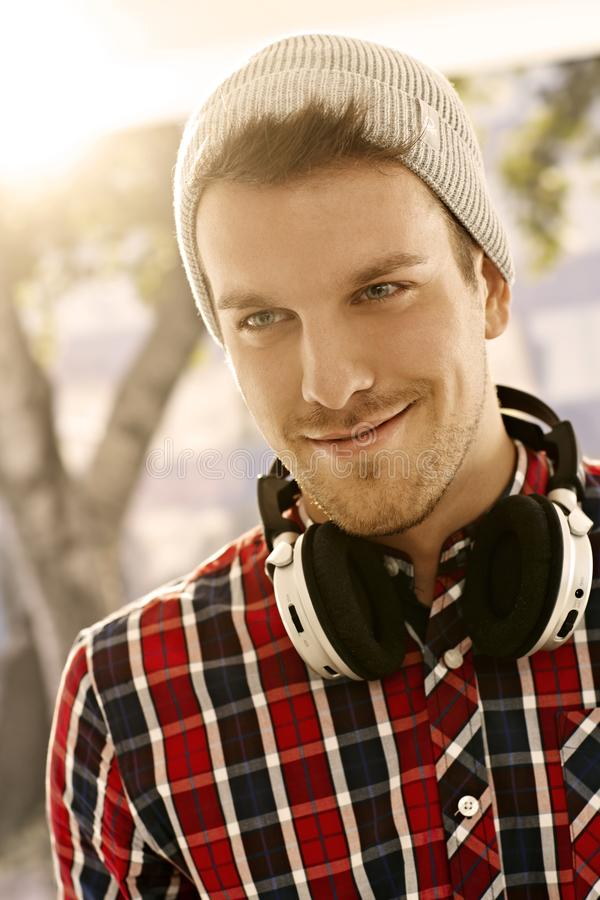 Portrait of trendy young man smiling royalty free stock images
