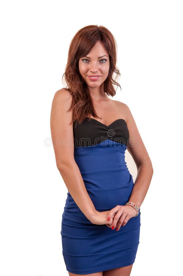 Portrait of trendy young woman in blue dress posing royalty free stock image