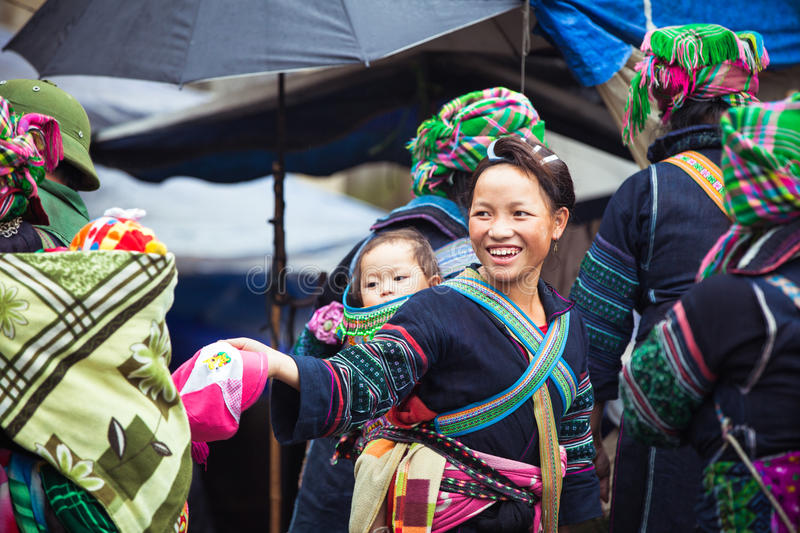 Portrait of tribal Hmong woman with baby in national clothes, Vietnam stock photography