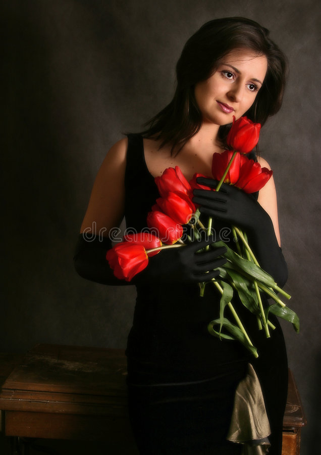 Portrait with tulips royalty free stock photos