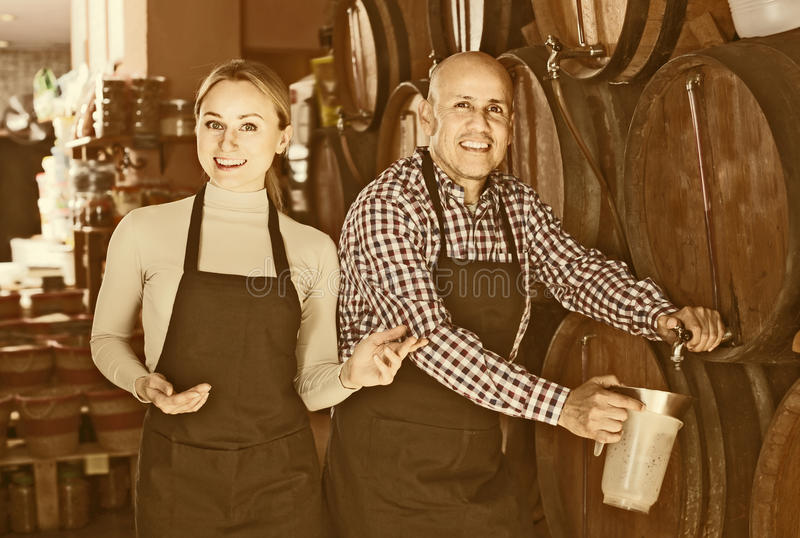 Portrait of two adult glad wine makers royalty free stock photography