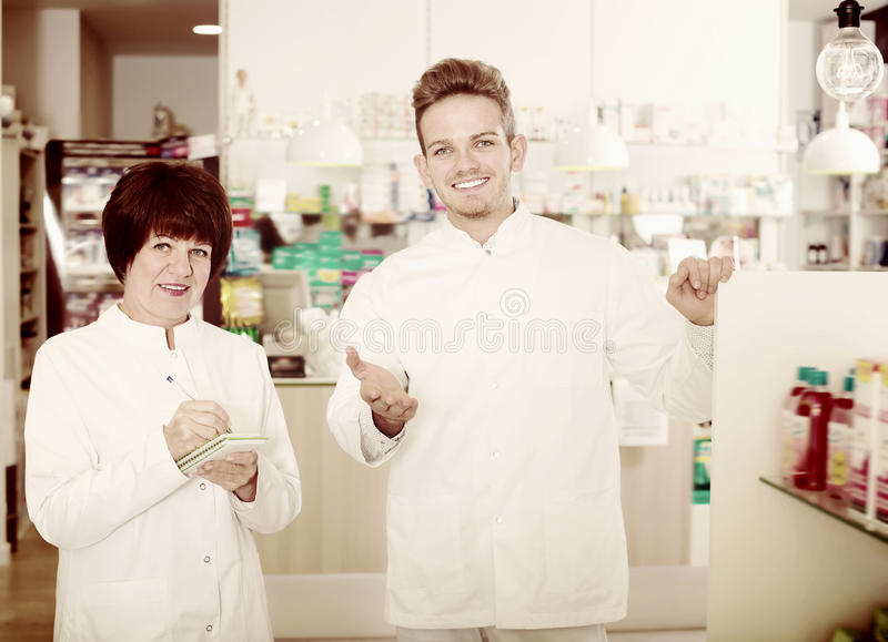 Download Portrait Of Two Adult Pharmacists Stock Photo - Image of manager, gown: 83701488