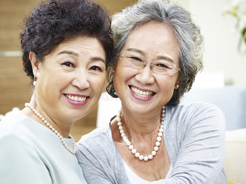 Portrait of two asian senior women royalty free stock image