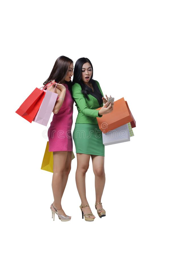 Portrait of two asian woman holding shopping bag with surprised royalty free stock photos