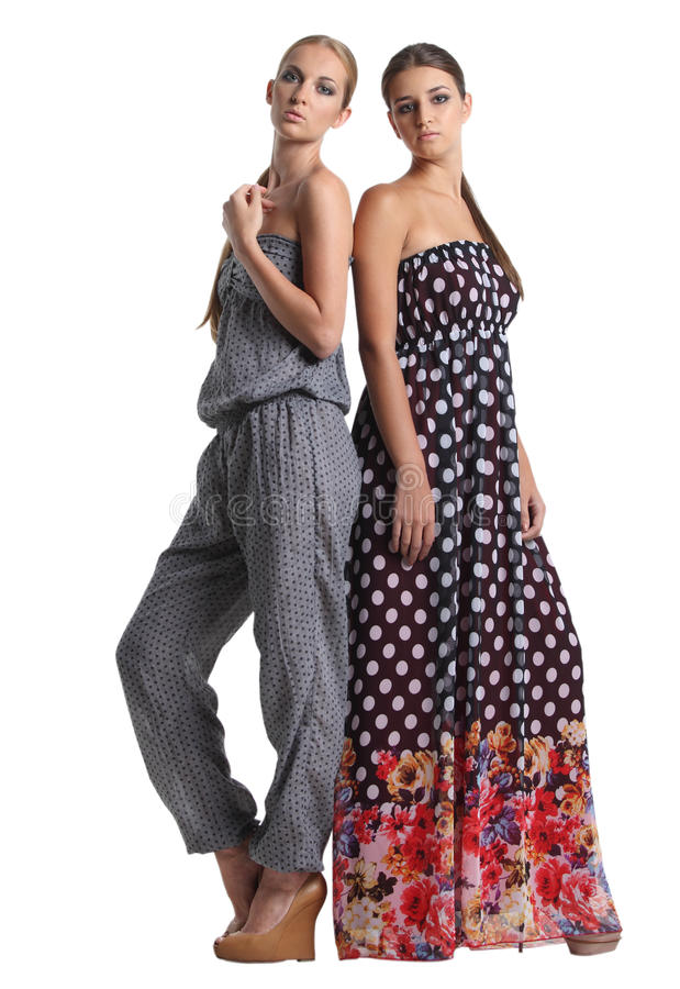 Portrait of two beautiful fashionable girls royalty free stock photography