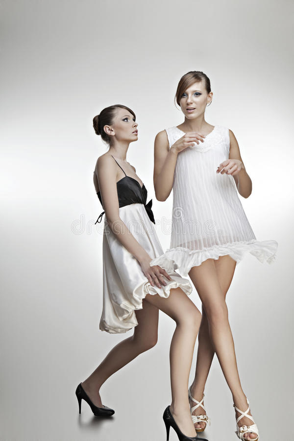 Download Portrait Of Two Beautiful Girls In Dresses Stock Photo - Image of person, cute: 23620786