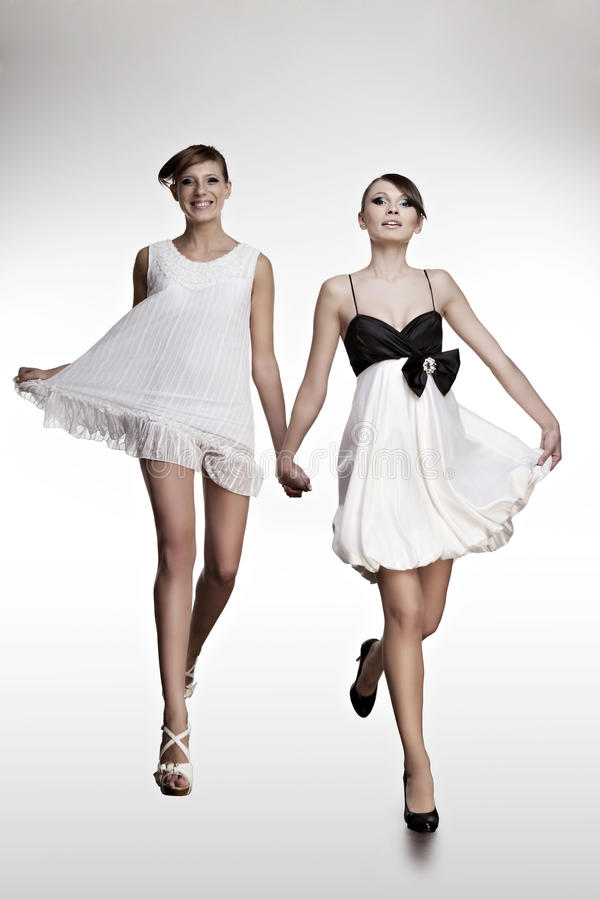 Download Portrait Of Two Beautiful Girls In Dresses Stock Image - Image: 23620805