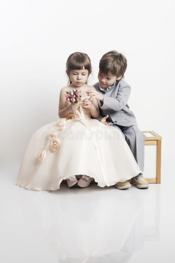 Portrait of two beautiful little boy and girl stock photos