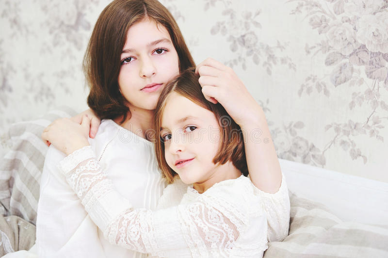 Portrait of two beautiful little girls stock photography