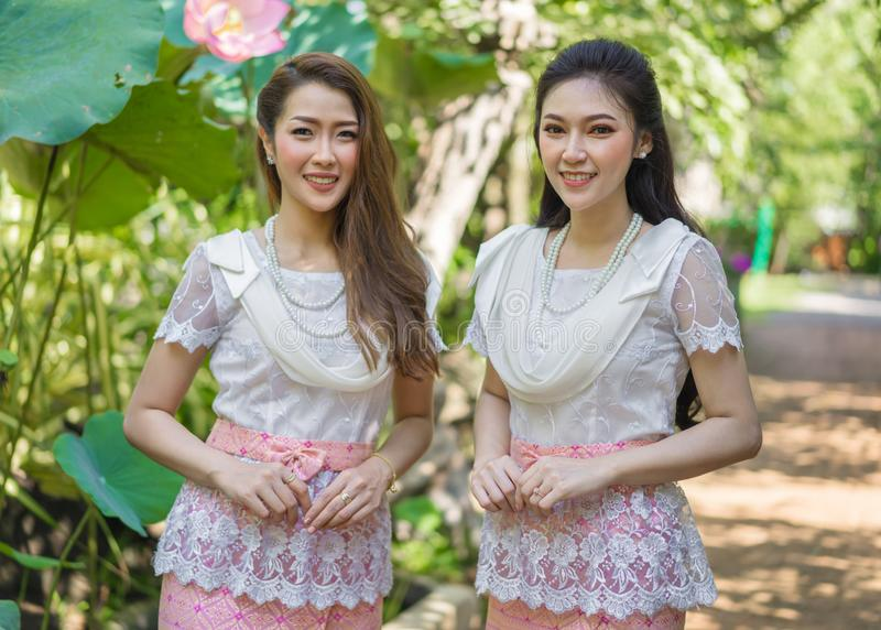 Two beautiful young woman in Thai traditional dress. Portrait of two beautiful young women in Thai traditional dress royalty free stock image
