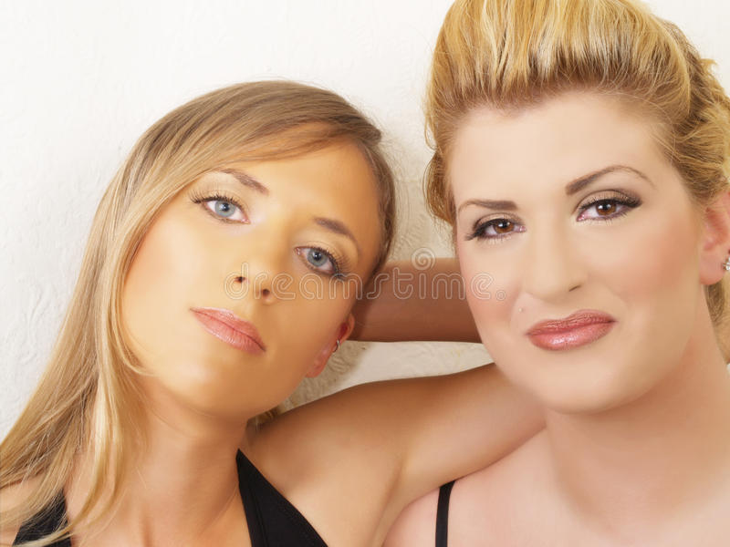 Download Portrait Of Two Blond Women Against White Wall Stock Image - Image: 13546921