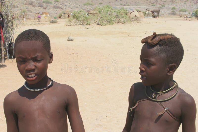 Portrait of two boys of the Himba tribe, Damaraland, Namibia royalty free stock photos