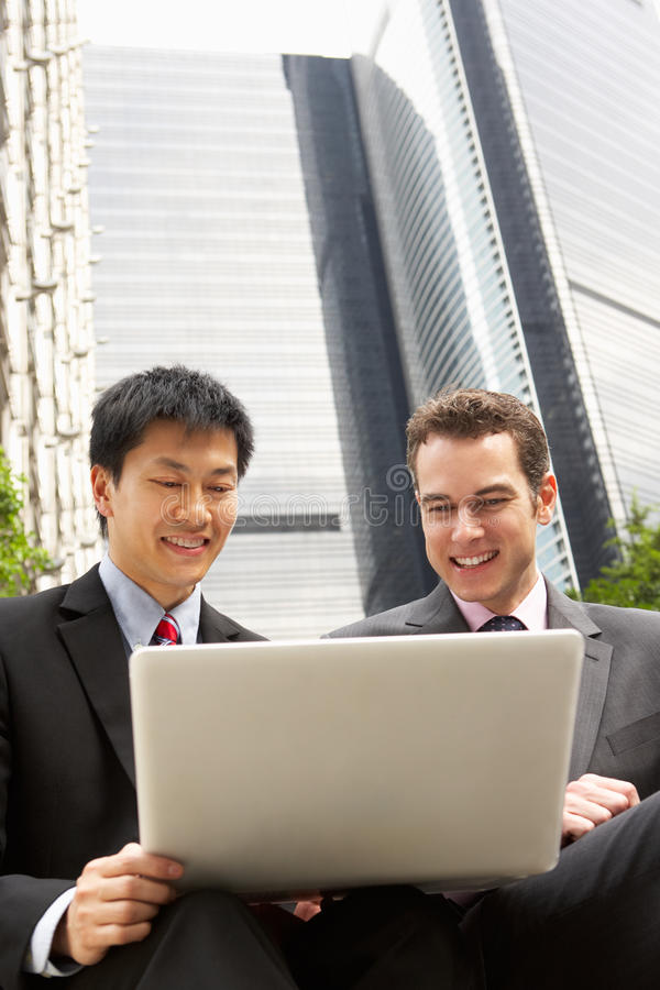 Download Portrait Of Two Businessmen Working On Laptop Stock Image - Image: 26093557