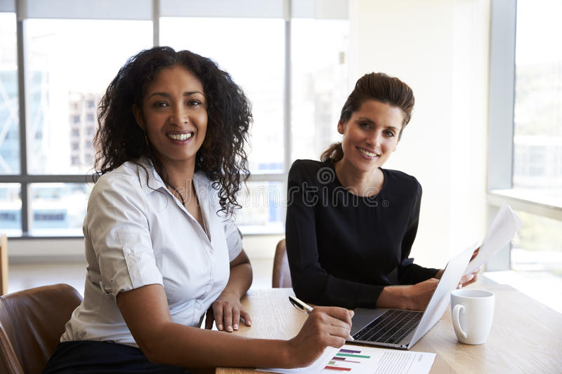 Portrait Of Two Businesswomen With Laptop Computer In Office royalty free stock photo