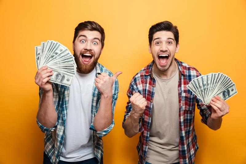 Portrait of a two cheerful young men royalty free stock images