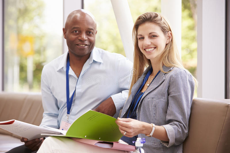 Portrait Of Two College Tutors Having Discussion Together stock photo