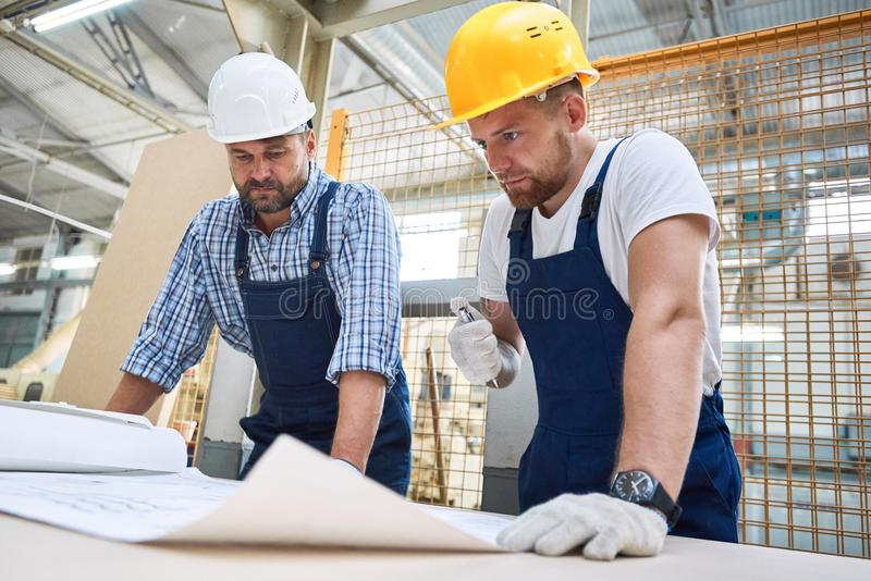 Two Construction Workers Inspecting Plans royalty free stock photos