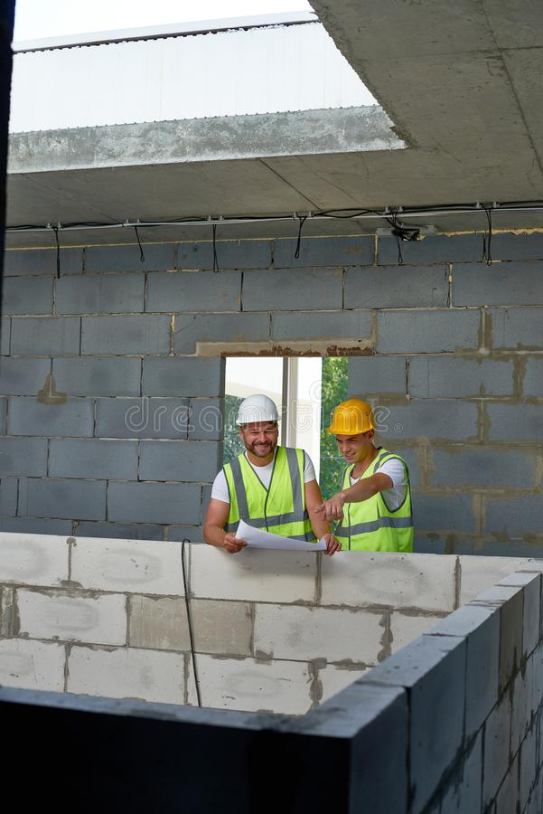 Cheerful Construction Workers on Site stock photography