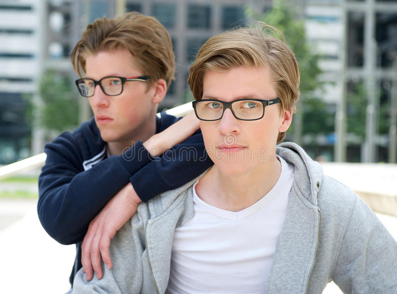Portrait of two cool brothers royalty free stock photography