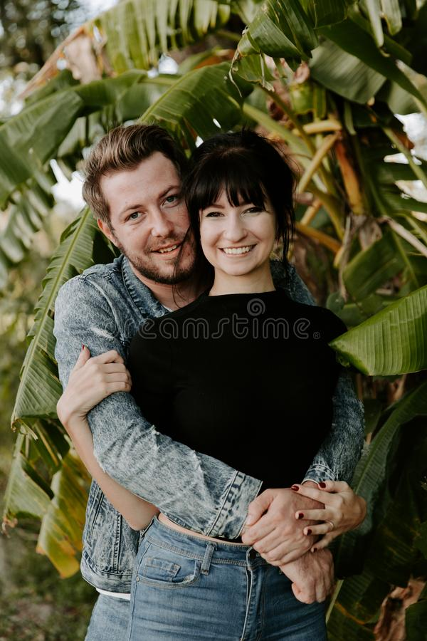 Portrait of Two Cute Modern Caucasian Beautiful Young Adult Guy Boyfriend Lady Girlfriend Couple Hugging and Kissing in Love in Na royalty free stock photos
