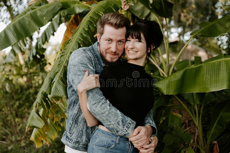 Portrait of Two Cute Modern Caucasian Beautiful Young Adult Guy Boyfriend Lady Girlfriend Couple Hugging and Kissing in Love in Na royalty free stock photography